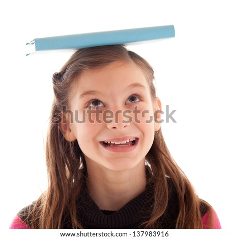 Young girl balancing a book on her head, isolated on white - stock photo