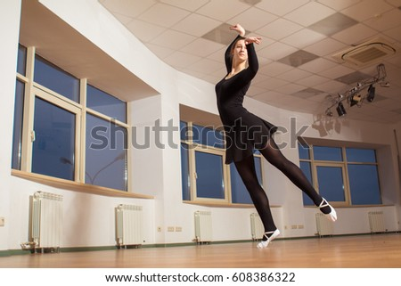 Young girl ballet dancer practicing in the hall for ballet lessons