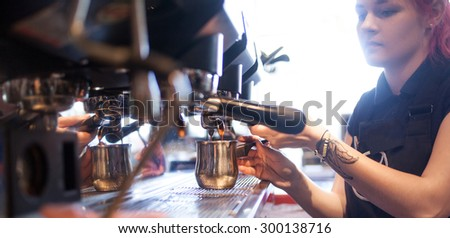 young girl Barista prepares coffee in pub, bar, restaurant - stock photo