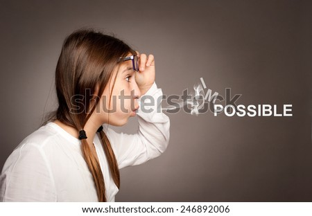 young girl blowing impossible word - stock photo