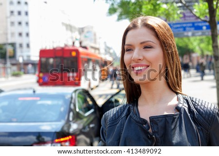 Young girl calling a taxi - stock photo