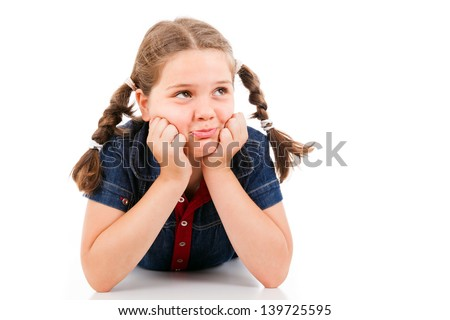 Young girl child looking at copyspace, isolated on white background