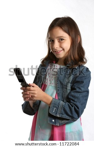 young girl / child texting on cell / mobile phone - against white background - stock photo
