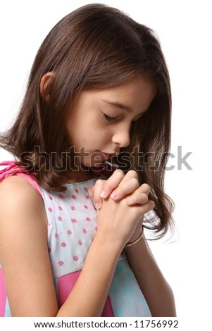 Young girl / child with head bowed in prayer - praying