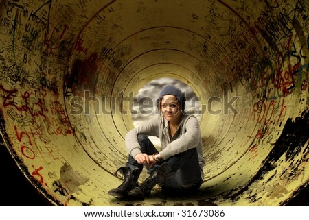 young girl cool looking in a tunnel - stock photo