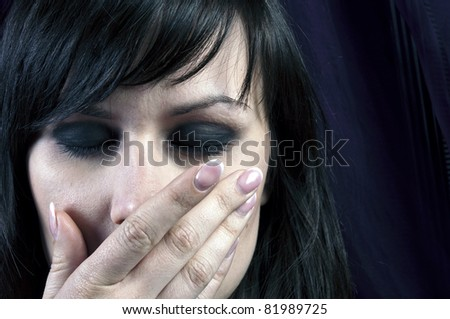 Young girl covering her mouth with her hand - stock photo