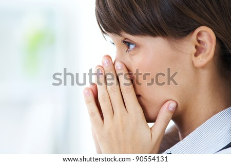 young girl crying closed  face in his hands - stock photo