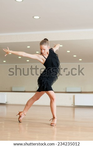 Young girl dancer doing exercises in a dance class - stock photo