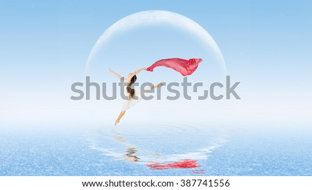 Young girl dancer on water surface - stock photo
