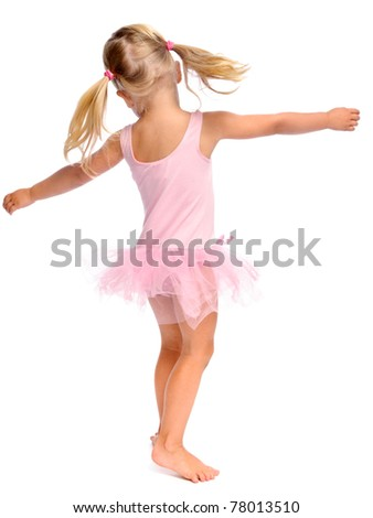 young girl dances ballet in her ballerina tutu, isolated on white in studio - stock photo