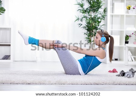 Young girl doing exercise for abdominals