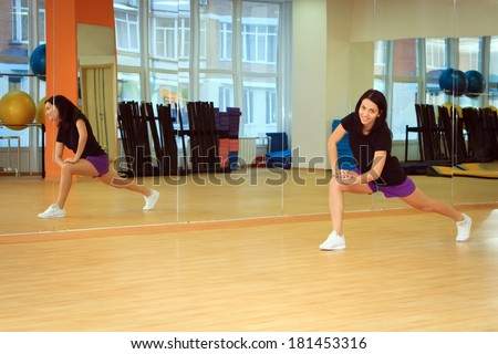 young girl doing fitness in the sport center - stock photo