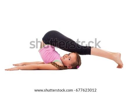 Young girl doing flexibility gymnastic exercise, side views, isolated