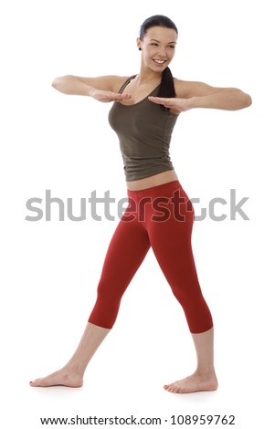 Young girl doing gymnastics, smiling, looking away. - stock photo