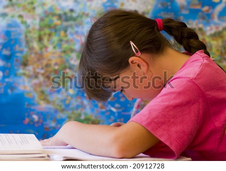 Young girl doing her school home-work.