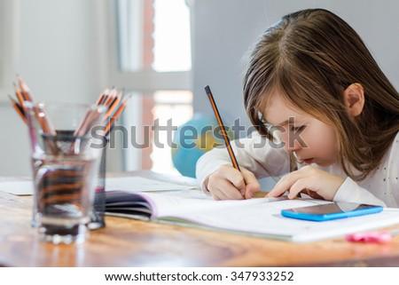 Young girl doing homework - stock photo