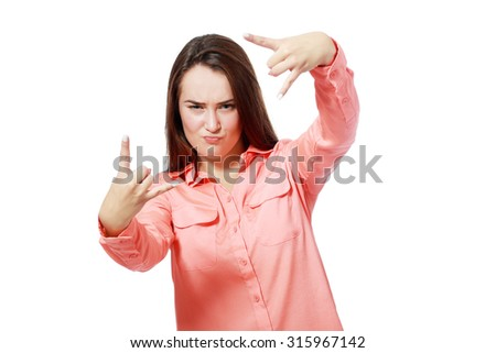 Young girl doing horn gesture over white background - stock photo