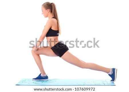 Young girl doing streching exercises over white background - stock photo