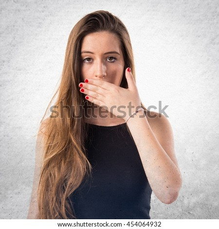 Young girl doing surprise gesture over textured background