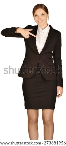 Young girl dressed suit presses forefinger in the empty space.
