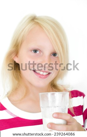 young girl drinking fresh milk