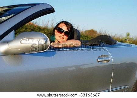 Young girl driving cabriolet ca - stock photo