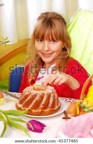 young girl eating easter ring cake