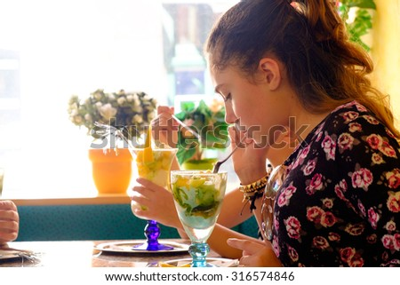 Young girl eats ice cream - stock photo