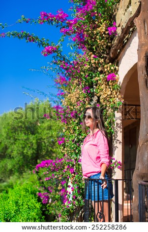Young girl enjoy summer vacation outdoors - stock photo