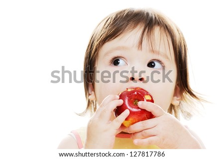 Young girl enjoying a fresh red apple - stock photo