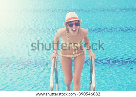Young girl enjoying outdoors in a swimming pool. - stock photo