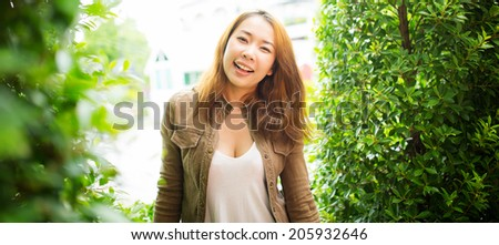 Young girl enjoying summer in the city's park - stock photo