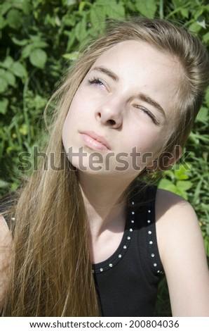 Young girl enjoys the sun - stock photo