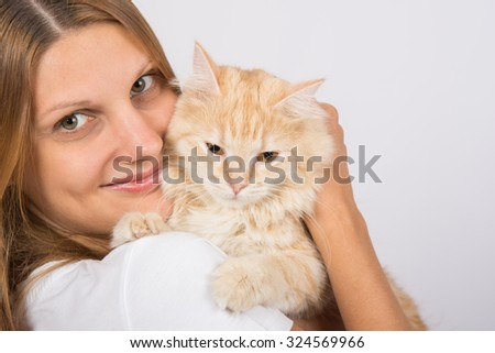 Young girl Europeans embracing his domestic cat - stock photo