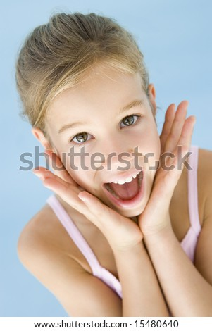 Young girl excited and happy - stock photo