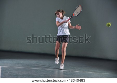 young girl exercise tennis sport indoor - stock photo