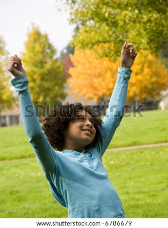 young girl expressing joy for life - stock photo