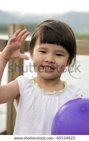 Young girl, funny playing outdoor