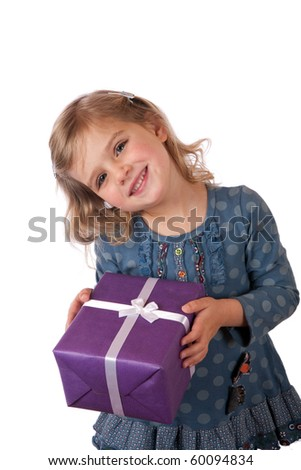 Young girl giving a present - stock photo
