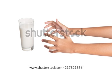 Young girl hand with a glass of milk - stock photo