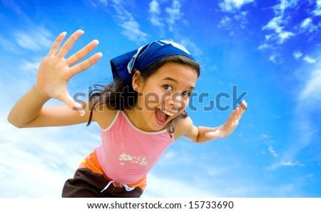 Young girl happy in swimming costume with beautiful blue sky in background - stock photo