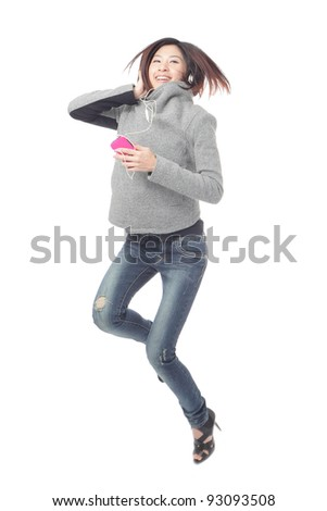 Young Girl happy jump and listen music by mobile phone isolated on white background, model is a asian beauty - stock photo