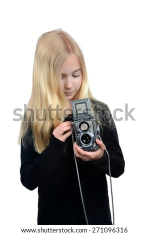 young girl holding a camera taking pictures isolated on white background - stock photo