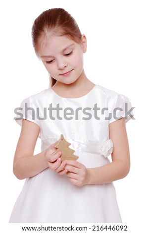 Young girl holding a Christmas tree isolated on white