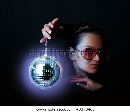 Young girl holding a disco sphere - stock photo
