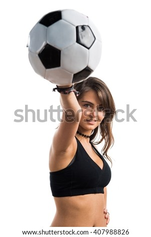 Young girl holding a soccer ball - stock photo