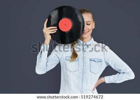 Young girl holding a vinyl disk to her face