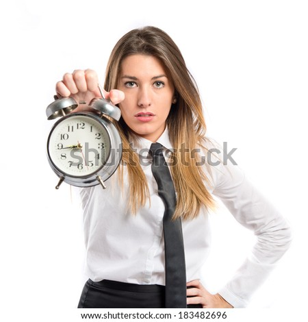 Young Girl holding an antique clock over white background  - stock photo