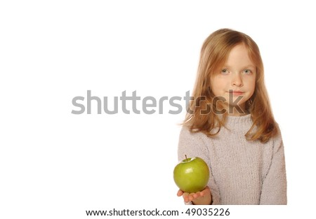 Young girl holding apple - stock photo