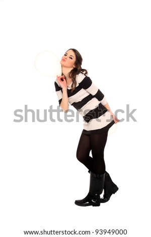 young girl holding balloons isolated on a white background